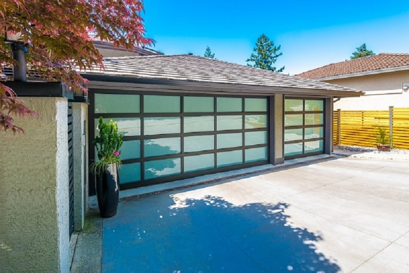 Tips To Save Money On Garage Door Repairs