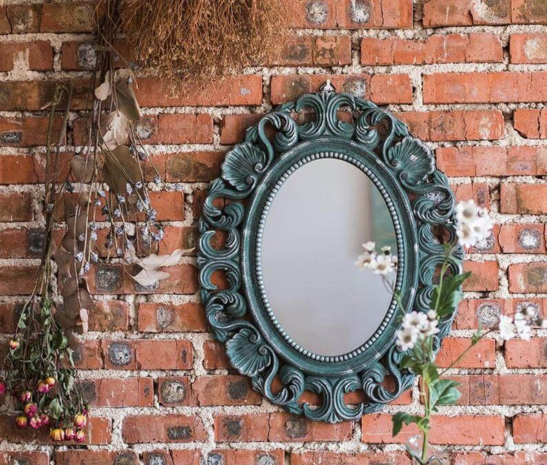 Small Antique Mirror that act as a Wall Centerpiece